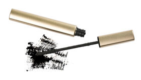 Mascara brush. With some mascara strokes on white Royalty Free Stock Photography