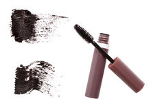 Mascara brush, tube and strokes Royalty Free Stock Photography