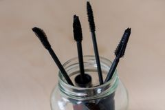 Mascara brushes in a glass jar Stock Photography