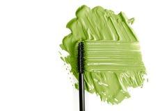Mascara e nappa verdi Sbavatura strutturata Isolato su priorità bassa bianca fotografia stock