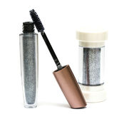 Mascara and gloss for lips. Silver mascara and gloss for lips Royalty Free Stock Photography