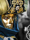 Mascarado no ouro Fotografia de Stock Royalty Free