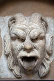 Mascaron ornament with sourse of water in collegium maius in cracow Royalty Free Stock Photo