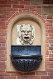 Mascaron ornament with sourse of water in collegium maius in cracow Stock Images