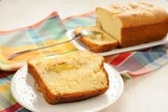 Mascarpone cake slice, long fork on white bright background Royalty Free Stock Image