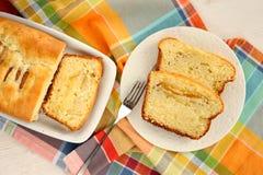 Mascarpone cake slice, long fork on white bright background top Stock Photography