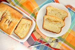 Mascarpone cake slice, long fork on white bright background top Stock Images