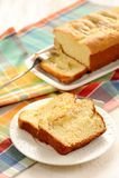 Mascarpone cake slice, long fork on white bright background Royalty Free Stock Images