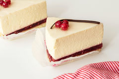 Mascarpone cheesecake with red currant and chocolate strip, serving slices. Delicious dessert with berries royalty free stock photos