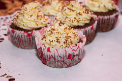 Mascarpone and Chocolate Cupcakes. Mascarpone cupcake and chocolate on a white wipes Royalty Free Stock Photo