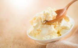 Mascarpone cream cheese close-up. Mascarpone Italian soft milk cream closeup, in wooden spoon. Homemade ice cream, yoghurt. 4K UHD video royalty free stock photo