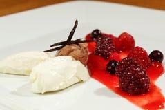 Mascarpone with nougat. Whipped mascarpone with vanilla garnished with fresh wild berries and nougat closeup stock images