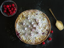 Mascarpone pie with fresh raspberries on a black background Stock Photos