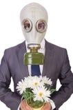 Maschera antigas d'uso dell'uomo d'affari Fotografia Stock Libera da Diritti