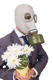 Maschera antigas d'uso dell'uomo d'affari Immagini Stock
