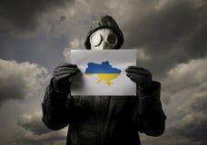 Maschera antigas e mappa dell'Ucraina Fotografia Stock