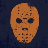 Maschera arancio dell'hockey su un fondo blu nello stile di lerciume Fotografie Stock