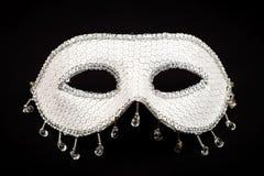Maschera bianca isolata sul nero immagini stock libere da diritti