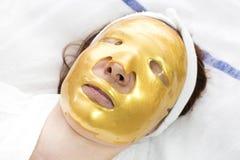 Maschera del cosmetico dell'oro Fotografia Stock Libera da Diritti