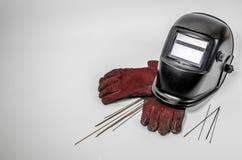 Maschera della saldatura con i guanti rossi Fotografie Stock Libere da Diritti