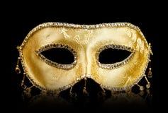 Maschera dorata sul nero fotografie stock libere da diritti