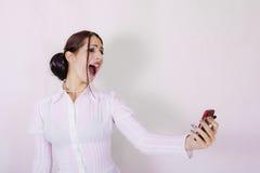 Maschera luminosa della donna di affari con il telefono delle cellule Immagini Stock