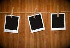 Maschere del Polaroid contro legno Fotografia Stock