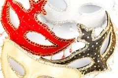 Maschere di carnevale su bianco immagini stock libere da diritti