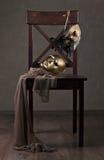 Maschere sulla sedia di legno Immagini Stock Libere da Diritti