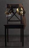 Maschere sulla sedia di legno Immagine Stock Libera da Diritti