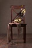 Maschere sulla sedia di legno Fotografia Stock