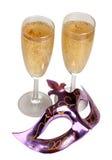 Mascherina e champagne Fotografia Stock