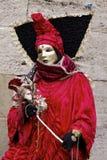 Mascherina ed abito rosso Immagine Stock
