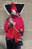 Mascherina ed abito rosso Fotografia Stock