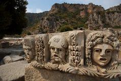 Mascherine di pietra del teatro, Myra, Turchia fotografia stock