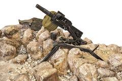 Maschinengewehr in den Felsen Stockbilder