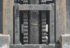Maschinerie mit Rost und Kette Stockfoto