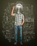 Maschio asiatico con scrittura della lampada qualcosa Immagine Stock