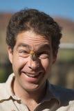Maschio con l'errore di programma della cicala sul fronte Fotografie Stock Libere da Diritti