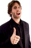 Maschio di risata con i pollici in su Immagine Stock Libera da Diritti