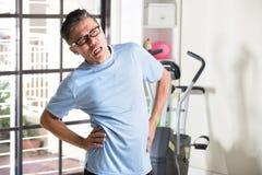 Maschio senior asiatico avendo lesione Fotografia Stock Libera da Diritti