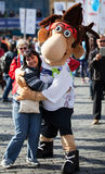 Mascot of International Prague Marathon 2012. With young lady Stock Photography