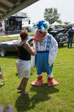 Mascot. Picture of duck mascot talking with a fan during woodstock family event the 5-6 july at ste-julie, quebec, canada Royalty Free Stock Images