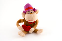 Mascot toy monkey with heart. Cute mascot stuffed toy monkey with heart on white Royalty Free Stock Photography