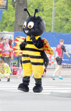The mascot, a wasp, before the start of the marathon race Stock Image