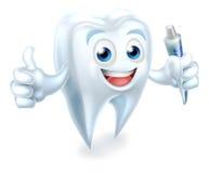 Mascota dental del diente que sostiene la crema dental Fotos de archivo libres de regalías