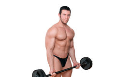 Mascular man lifting weights. Stock Photography