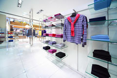 Masculine clothes are for sale in shop. Masculine clothes are for sale in modern shop stock image