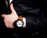 Masculine hand with a clock Royalty Free Stock Photos