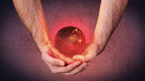 Masculine hands holding a 3d planet globe with videos about Christmas Royalty Free Stock Photography